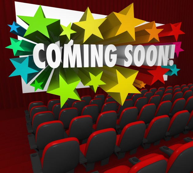 A movie theatre of red chairs and a screen with the words Coming Soon in 3d letters surrounded by colorful stars