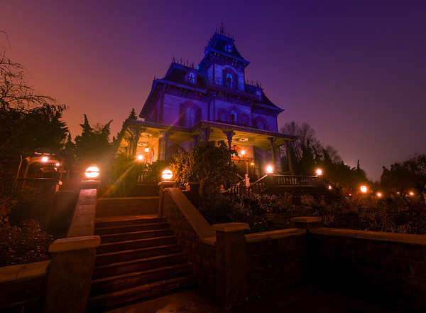 Phantom Manor in Disneyland Paris on a foggy morning at dawn. Check out our Phantom Manor photo walk through (76 photos): https://www.disneytouristblog.com/phantom-manor-photo-ride-through/