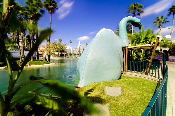 Notice the streaking clouds and moving palms? This is a 23-second photo of Gertie the Dinosaur, made possible with a neutral density filter. More about ND filters: https://www.disneytouristblog.com/neutral-density-filter-reviews-buying-guide/