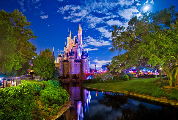 On this particular night at Walt Disney World, Cinderella Castle in the Magic Kingdom was lit up by a brilliant full moon, rather than the artificial light normally on the Castle. Read more: https://www.disneytouristblog.com/cinderella-castle-by-the-light-of-the-moon/