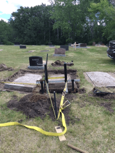 Using the Tombstone Jack creatively to raise sunken grave covers