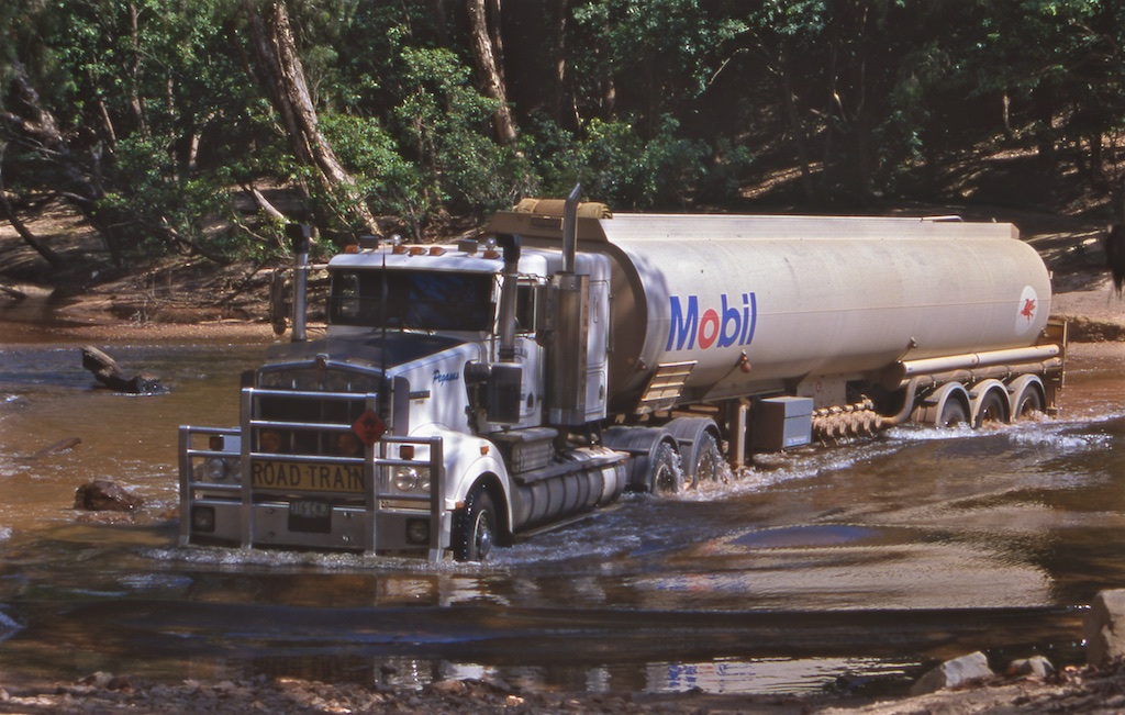 "Garry White, ""the world's toughest trucker,"" delivers diesel fuel to the cattle stations, aboriginal communities and remote settlements of the Cape York Peninsula in far north Queensland, Australia. Writer and photographer Tom Clynes rode along on his 2,400 km round trip through the continent's most inaccessible wilderness."