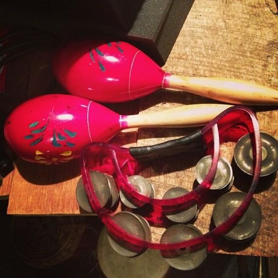 Red maracas and tambourine in studio #stilllife #joy