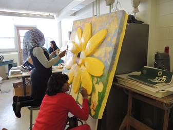 """Cheyney University students Zakia C. Royster and Rosalyn Mitchell-Jackson, add their touches to the multi-media piece  created as part of the """"Celebrating the Art of Collaboration"""" joint project with residents of Kendal."""