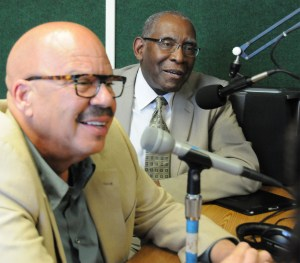 Tom Joyner, second from left, poses with UVI President Dr. David Hall, at right, and some of the crew of UVI's student radio station – WUVI 1090 AM.
