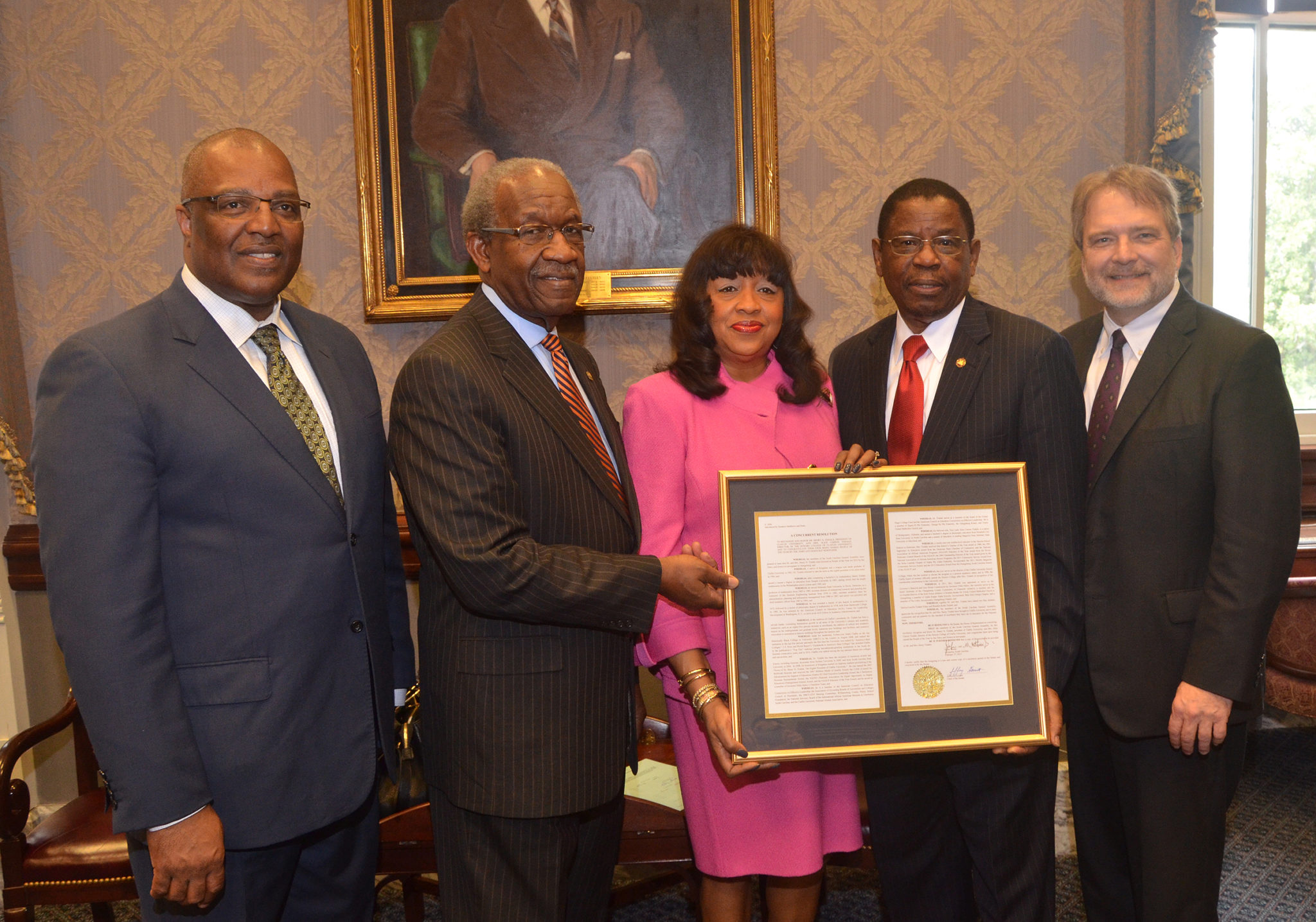 Pictured are, from left, Orangeburg Mayor and Claflin University alumnus Michael Butler, state Sen. John Matthews of Orangeburg, Claflin First Lady Alice Carson Tisdale, Claflin President Dr. Henry N. Tisdale and state Sen. Brad Hutto of Orangeburg. The Tisdales were honored on Tuesday with a resolution from the S.C. Senate and House of Representatives for their 20 years of visionary leadership and service at the University and beyond.