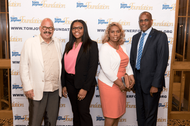 From left: Tom Joyner, Full Ride Scholarship Finalist Alexis Washburn, her mother and Dillard University President Dr. Walter Kimbrough. (Photo: Jesse Hornbuckle)