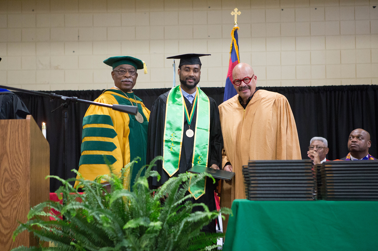 (From left: Concordia College President Dr. William Craft, a graduating student and TJF Founder Tom Joyner at the 2018 Concordia College Commencement. (Photo: Willie Harris II)