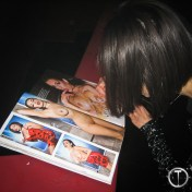 Darcie signing the magazine for an adoring fan.