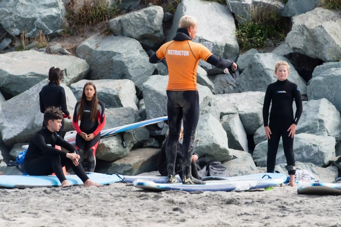 surf instructor with kids