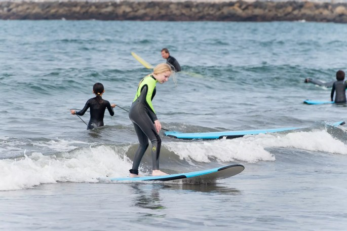 kid surfing a small wave