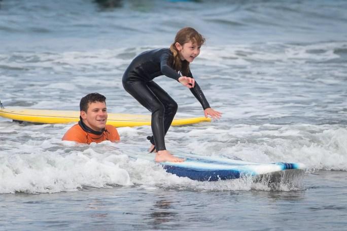 instructor teaching surfing