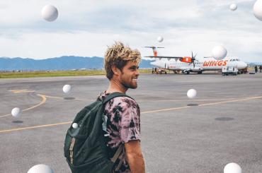 Dylan standing near an airport runway