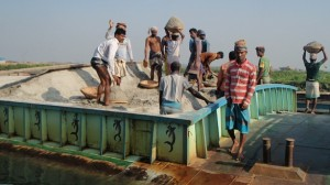 Heavy Lifting: Unloading the Sand Boats