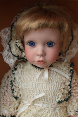 creepy-doll-with-big-blue-eyes