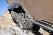 This Jeeps plastic fenders were smashed up against the rock, and then the driver ran them over