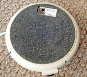 Picture of the Marpac Dohm SleepMate 980A, showing its underside and its foam rubber footing for better vibration isolation.