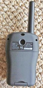 Radio Shack Weather Alert Radio 12-522. Picture of the all hazards weather radio, rear view. It shows the product label and battery compartment door.
