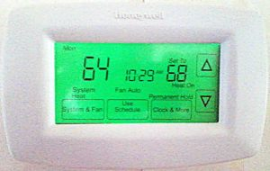 Picture of an installed and operating RTH7600D Programmable Thermostat by Honeywell.