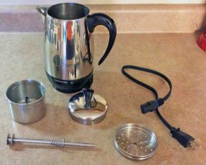 Picture of the Farberware FCP280 electric coffee maker, disassembled, showing all Its parts. Clean stainless steel coffee maker.