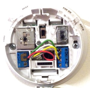 How to wire a Honeywell thermostat with 4 wires. Picture of the mounting plate with four wires, of the Honeywell large dial thermostat, model T87N1026.