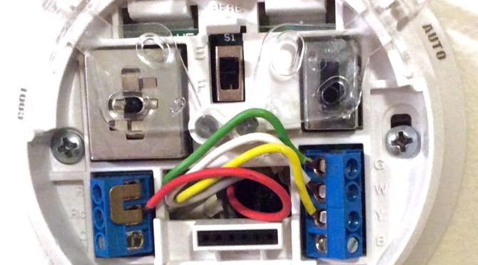 Picture of the Wired mounting plate of the Honeywell Thermostat, model Picture of the Rear of the control unit for the Honeywell Large Dial Thermostat Picture of the installed Honeywell Large Dial Thermostat, T87N1026.