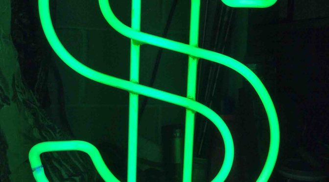 Picture of a green glowing neon money sign lamp, featuring mercury vapor gas, blue based fluorescence.