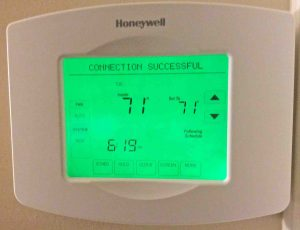 Picture of the touchscreen of the Honeywell RTH8580WF Wifi Thermostat, showing SUCCESS messsage after having properly logged into the new wireless network.
