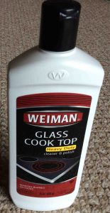 Picture of the front of a bottle of Weiman glass cook top stove cleaner.