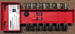 Pictre of the rear view of the 16 Piece Universal Socket Ratchet Set by Husky Tools in the included plastic holder keeper.