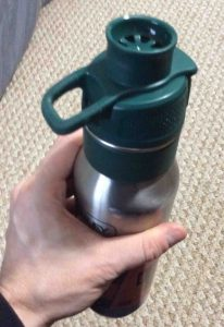 Picture of the Stanley 24-ounce One Handed Hydration Bottle, fitting comfortably into hand.