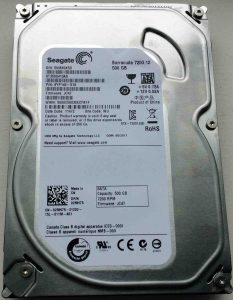 How to recover a hard drive that is clicking. Picture of a Seagate Barracuda SATA 500 GB HDD, top view.