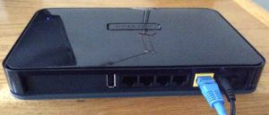 Picture of the rear view of the Netgear WNDR4300 N750 Wi-Fi router. Showing the USB, Internet Ethernet, and power ports as well as the power switch. Netgear N750 WNDR4300 review.