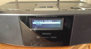 Picture of the Denon S-32 Internet Radio, displaying the -Network Setting- screen after successful Wi-Fi connection established, with the -Exit- menu item selected.