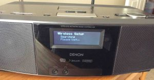 Picture of the Denon S-32 Network Media Player, Displaying the --Searching for In-Range Wireless Networks-- Screen.