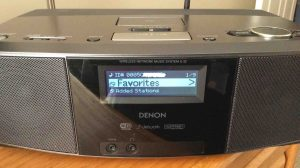 Picture of the Denon S-32 Network Music Player, displaying its Main Menu after successful Wi-Fi connection established. The reconnect WiFi process succeeded.