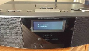 Picture of the Denon S-32 internet radio, displaying the -Connection Succeeded- screen after successful reconnect WiFi procedure.
