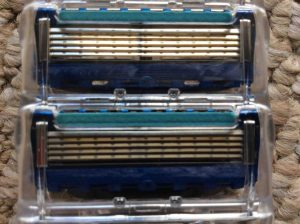 Picture of the Gillette Fusion Blade Cartridges, showing the blue lubrication strip.