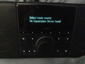 Picture of the Logitech Squeezebox Boom Radio, displaying the Select Music Source screen.