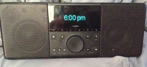 Picture of the Logitech SqueezeBox Boom Internet Radio, in Standby OFF Mode, showing the current time of day on its display.