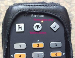 Picture of the Victor Reader Stream, New Generation, showing Wireless Button and Wireless Status Lamp, labeled in pink text.