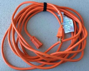 Picture of an orange outdoor extension cord with a single outlet, for increased extension cord safety.