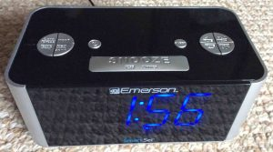 Picture of the Emerson™ CKS1708 SmartSet Clock Radio, top front view, showing blue LED display and the buttons.