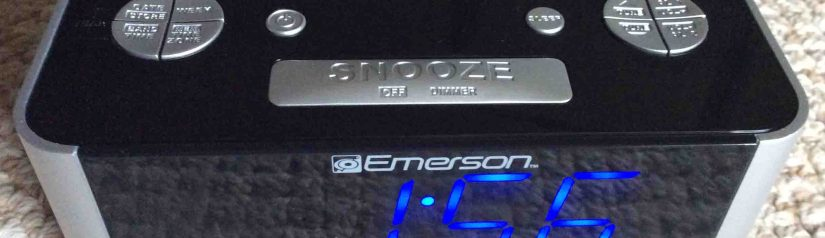 Picture of the Emerson CKS1708 SmartSet Clock Radio, top front view, showing blue LED display and the buttons.