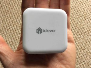 Picture of the iClever dual USB wall Charger IC-TC02 AC adapter, flat side view.