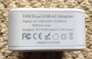 Picture of the iClever IC-TC02 Two Port USB Wall Charger, showing the label side view.