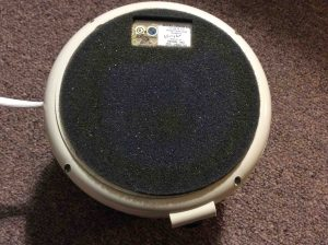 Picture of the Dohm DS white noise machine, bottom view, showing vibration absorbing pad and model information tag.