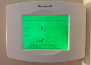 Picture of the Honeywell RTH8580WF Thermostat, displaying main screen after factory defaults reset.