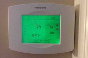 Picture of the Honeywell RTH8580WF Thermostat, displaying its Home screen.