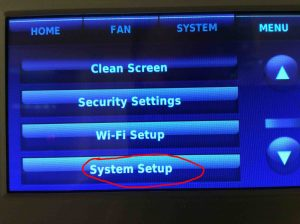 Picture of the Honeywell RTH9580WF Smart WiFi Thermostat, Menu, System Setup button highlighted.